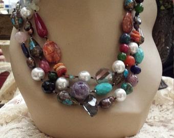 three strand Semi-precious designer made necklace with lots of color