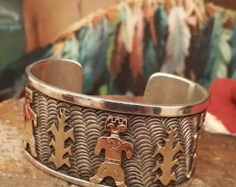 Vintage Native American Sterling Silver and 14K Gold Cuff Bracelet (Man in the Maize) Signed Piece
