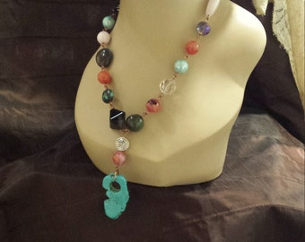 One strand beaded necklace made with faceted assorted stones and turquoise drop