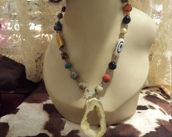 One strand beaded faceted assorted necklaces with center drop