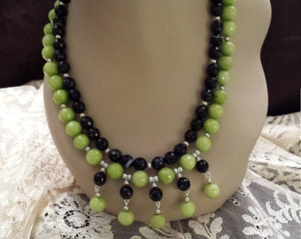 Two strand faceted jade and black onyx necklace with center drops