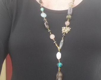 Long strand beaded adjustable strand necklace