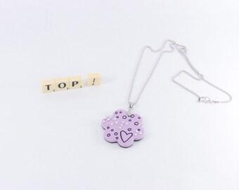 "Flower pendant ""top!"" in braille"