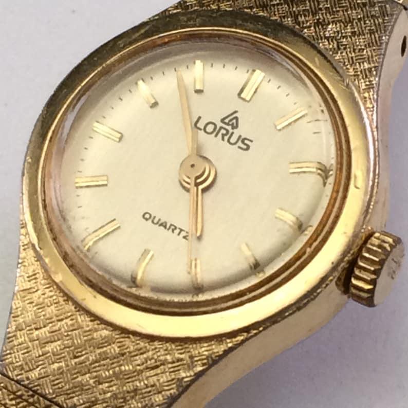 e537e8393532 Lorus Vintage dorado cuarzo analógico reloj V236-0050 de la