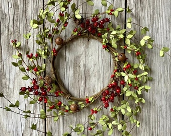 Christmas Wreath with Red Pip Berries and Rusty Jingle Bells
