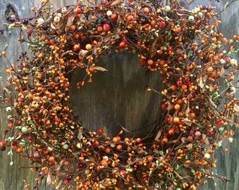 Fall Wreath with Burgundy, Orange, and Green Pip Berries