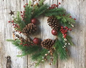 Christmas Pine Wreath with Red Bells, Rusty Stars, Jingle Bells, and Pine Cones
