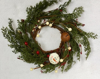 Pine and Cedar Candle Ring with Snowman and Candy Cane