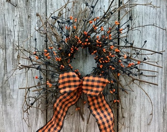 Halloween Twig Wreath with Black and Orange Pip Berries