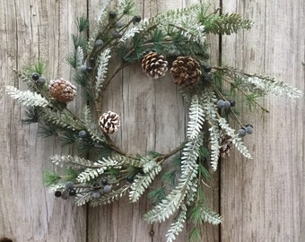 Flocked Pine and Red Pip Berry Christmas Wreath