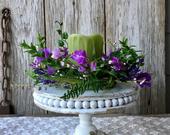 Distressed White Pedestal with Flameless Candle and Purple Floral Candle Ring