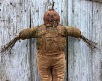 Scarecrow with Jack-O-Lantern Head