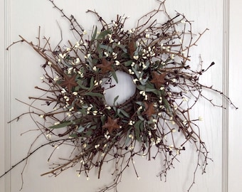 Christmas Wreath with Pip Berries and Rusty Stars