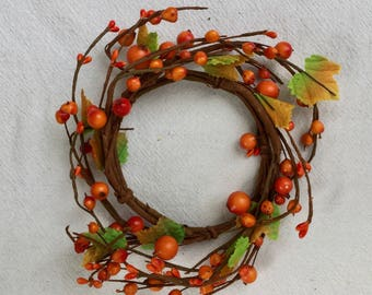 Fall Candle Ring with Bright Orange Pip Berries and Green Leaves