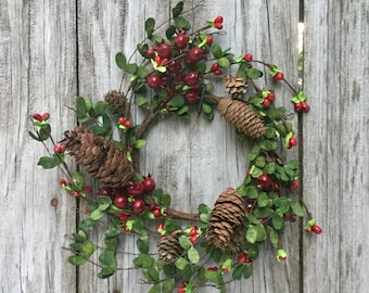Christmas Boxwood Candle Ring with Red Berries, Pine Cones and Bells