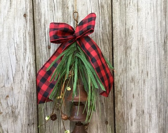 Rusty Bell Hanger with Pine Cones, Berries and Holiday Ribbon
