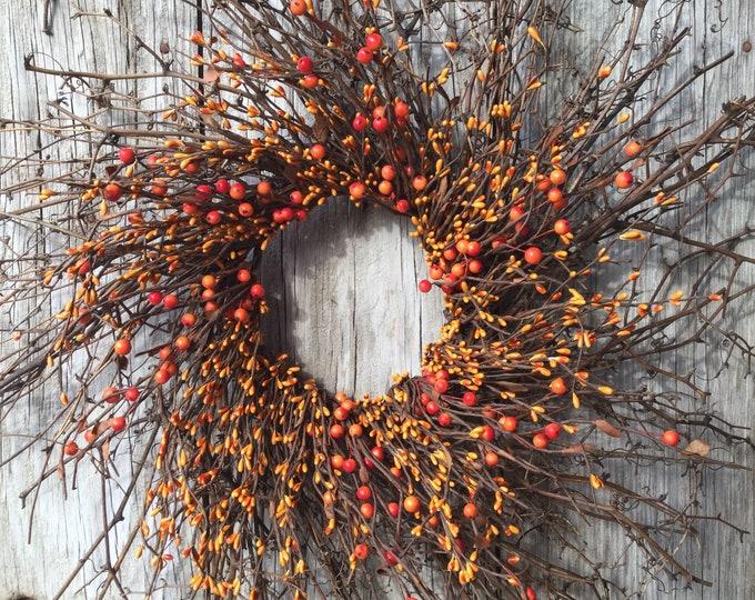 Featured listing image: Twig Sunburst Wreath with Orange Pip Berries