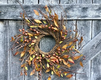 Fall Wreath with Orange and Brown Berries and Leaves