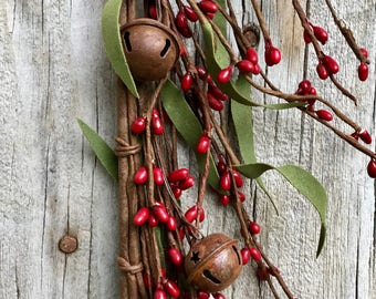 Red Pip Berry Garland with Rusty Jingle Bells and Green Leaves