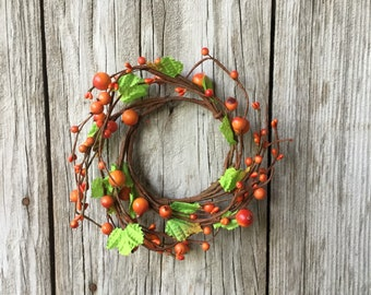 Orange Mixed Berry Candle Ring with Green Leaves