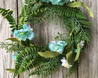 Teal Flower Candle Ring with a Mixed Greenery and Ferns