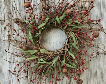 Rustic Christmas Wreath with Rusty Bells, Pip Berries and Green Leaves