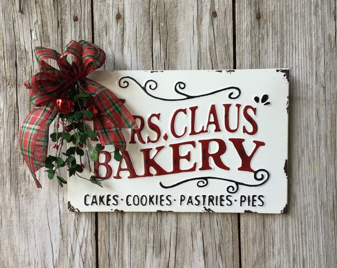 Featured listing image: Mrs Claus Bakery Sign with Pine and Rusty Bow, Christmas Decor, Santa Claus Decor, Bakery Sign, Mrs. Claus, Christmas Sign, Free Shipping