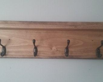 Rustic coat rack with floating shelf.