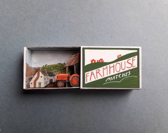 Farmyard with red tractor, matchbox.