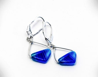 Sterling silver earrings with milky aquamarine triangles made of high quality pressed glass.