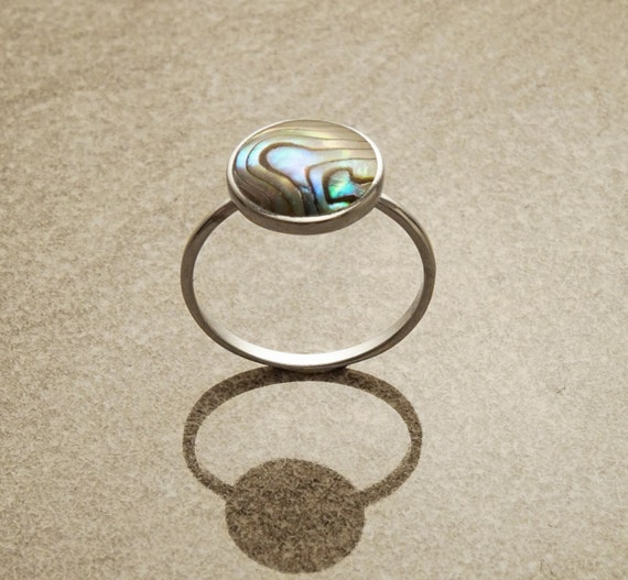 Round stone ring, sterling silver set with genuine paua shell in a modern geometric design