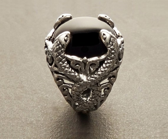 Black Onyx Gemstone Snakes Ring, with an intricate pattern of swirling snakes coiling around the Genuine Onyx Cabochon. Design Handmade Ring