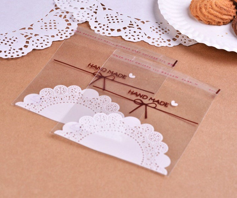 100x Handmade Lace Doilies OPP Cookie Bags \u2022 Party Wedding Favor Bags Gift Bags \u2022 Sweets Bar Buffet Decoration Bags \u2022 1st Birthday Gift Bags
