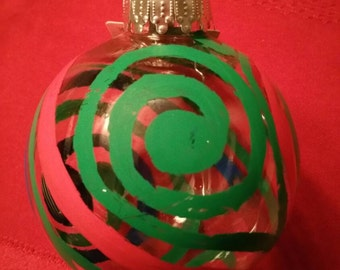 Translucent xmas ornaments with multicolor spirals.
