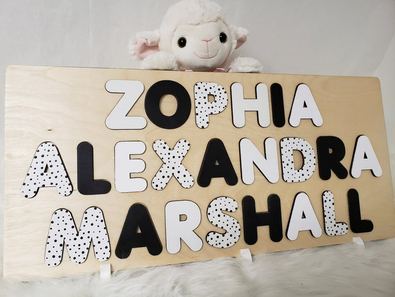 Wooden Name Puzzle With Three Names Black And White With Polka image 0