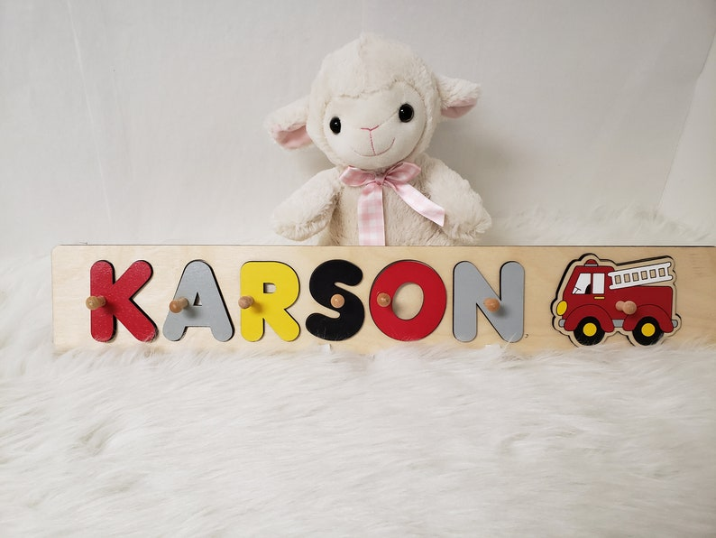 Wooden Name Puzzle with Knobs And Fire Truck image 0