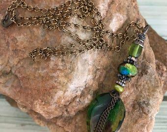 Green lampwork glass pendant