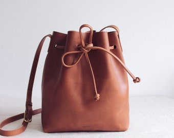 5d418a5e05 brown leather bucket bag    leather tote bag    leather purse    vegetable  tanned leather tote    minimal