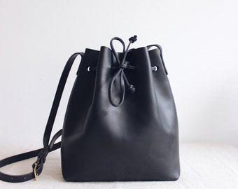 a9773a703265 black leather bucket bag    leather tote bag    leather purse    vegetable  tanned leather tote    minimal