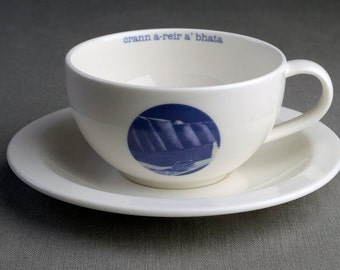 A Mast to Suit the Boat - Ceramic tea cup & saucer with decal print titled 'crann a-rèir a' bhàta'
