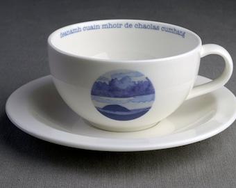 Making a Great Ocean of a Narrow Strait - Ceramic tea cup & saucer with decal print titled 'dèanamh cuain mhòir de chaolas cumhang'