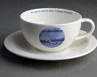 The Twist in an Old Stick - Ceramic tea cup & saucer with decal print titled 'an car a bhios san t-sean  mhaide'