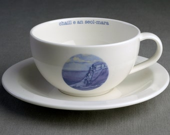He Lost the Tide - Ceramic tea cup & saucer with decal print titled 'chaill e an seòl-mara'