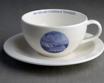 Unexpected Turn of Events - Ceramic tea cup & saucer with decal print titled 'car eile air ruidhle a' bhodaich'