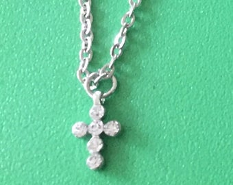 Doll cross necklace