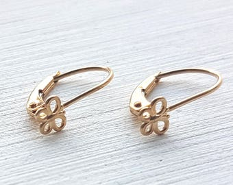 14K Solid Yellow Gold Leverback Earrings with a butterfly ornament