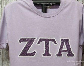 41e79675 Very Limited Sizes Available, Orchid Unisex Short Sleeve Classic T-Shirt  White Background #291 Print Greek Double Stitch Letters