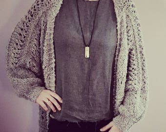 Hand knitted oversized alpaca cardigan made by soft alpaca yarn. Available in ten (10) colors.