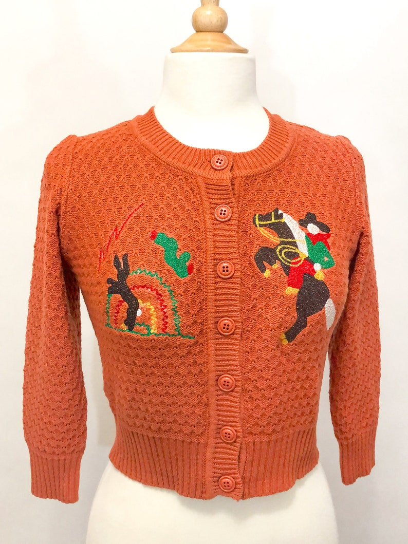 Vintage Western Wear Clothing, Outfit Ideas     Head West! Cardigan in Dusty Orange size SML XL Sweater Vintage inspired By MISCHIEF MADE $59.00 AT vintagedancer.com