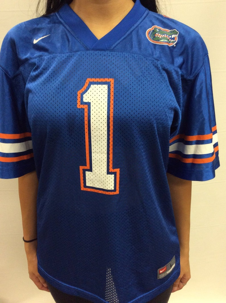 8fdbe47dea4 Vintage University of Florida Nike Football Jersey Size Youth | Etsy